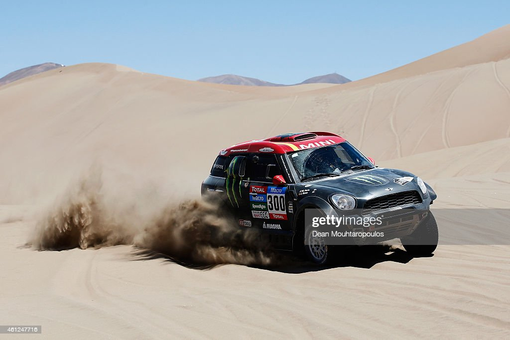 Nani Roma of Spain and Michel Perin of France driving for the ALL4 Racing Mini Monster Energy Rally Raid Team compete during day 6 of the Dakar Rallly between Antofaasta and Iquique on January 9, 2015 near Iquique, Chile.