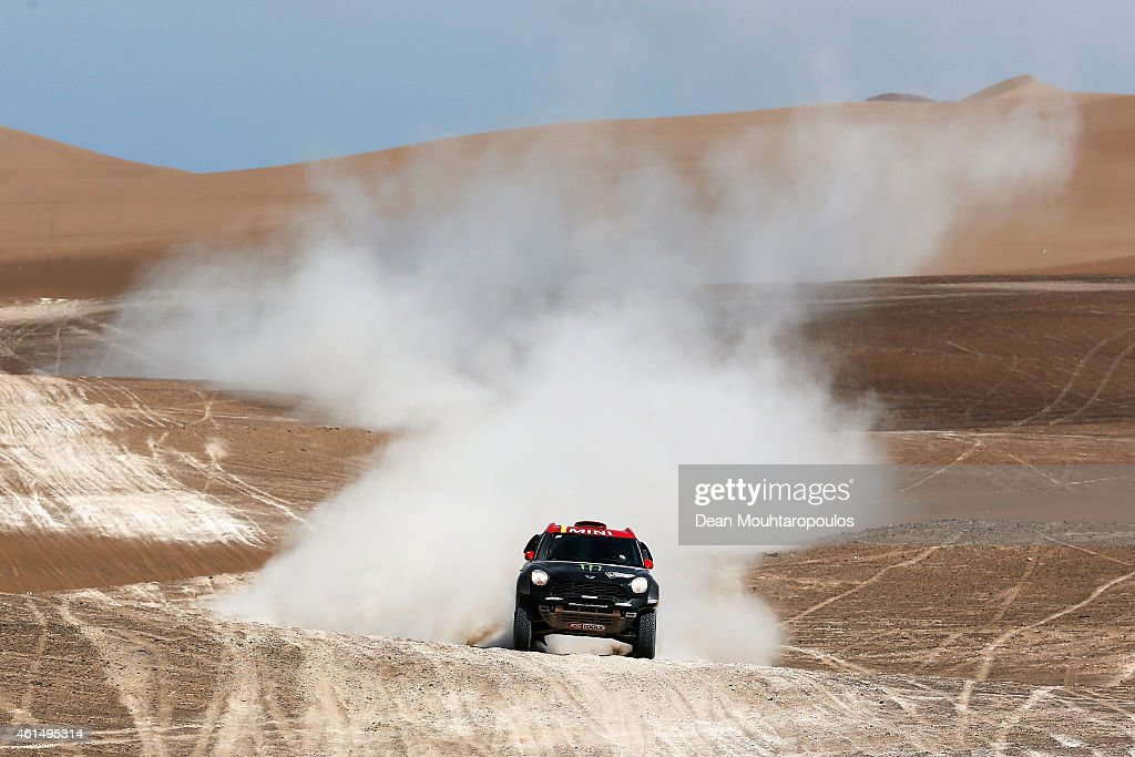 Nani Roma of Spain and Michel Perin of France driving for the ALL4 Racing Mini Monster Energy Rally Raid Team compete in the Atacama Desert during day 10 of the Dakar Rallly between Iquique on Calama January 13, 2015 in Iquique, Chile.