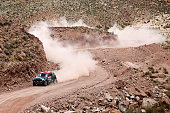 Nani Roma of Spain and Michel Perin of France driving for the ALL4 Racing Mini Monster Energy Rally Raid Team compete near the Salinas Grandes during...