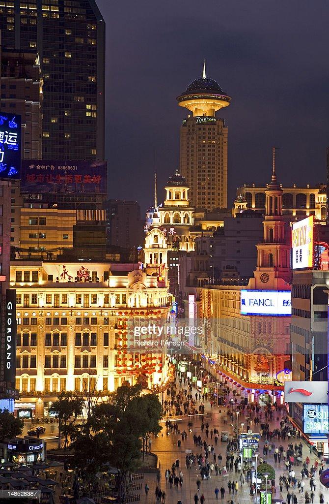 Nanjing Road (East) & city buildings at dusk.