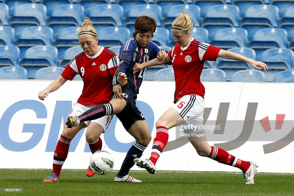 Nanna Christiansen and Janni Arnth Jensen of Denmark challenges Asano Nagasato of Japan during the Algarve Cup 2013 match between Denmark and Japan at the Algarve stadium on March 11, 2013 in Faro, Portugal.