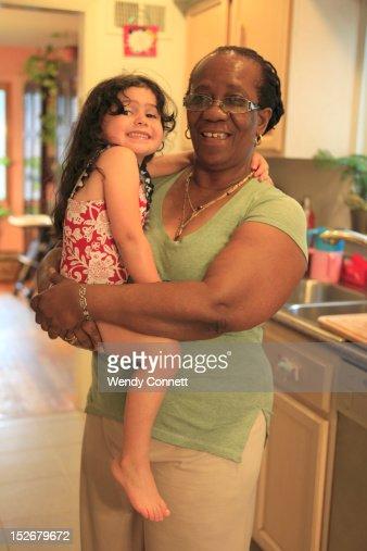 Nanny holding little girl : Stock Photo