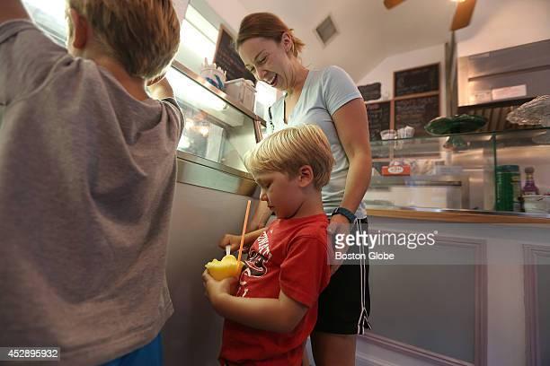Nanny Nicole Gagne takes her charges Freddie van der Velden left and George van der Velden into Park Street Ice Cream Cafe