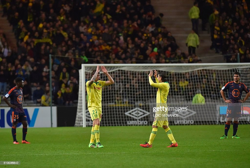 Nantes' Argentinian forward Emiliano Sala (2nd L) celebrates after scoring a goal during the French L1 football match between Nantes (FCN) and Lorient (FCL) at La Beaujoire Stadium in Nantes, western France, on February 13, 2016. AFP PHOTO / LOIC VENANCE / AFP / LOIC VENANCE