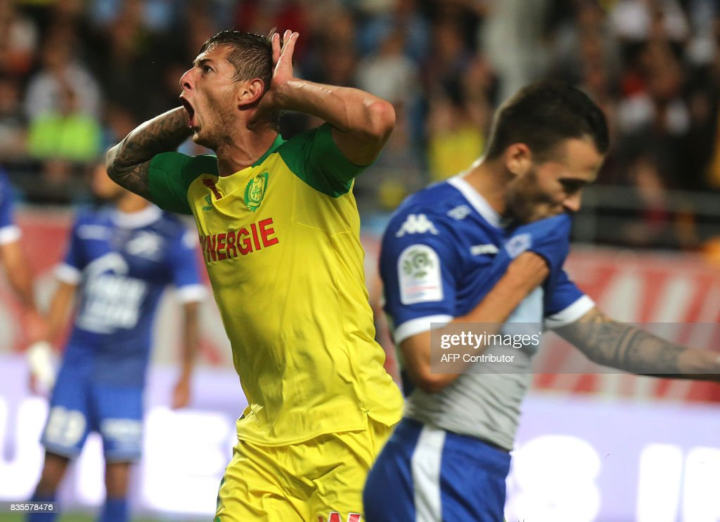 Nantes' Argentinian forward Emiliano Sala (L) celebrates after scoring a goal during the French L1 football match between Troyes (ESTAC) and Nantes (FCN) on August 19, 2017, at the Aube stadium in Troyes, eastern France. /