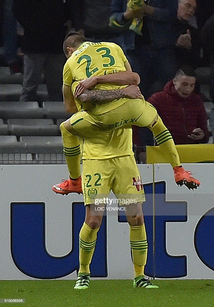 Nantes' Argentinian forward Emiliano Sala (down) celebrates with Nantes' Brazilian midfielder Adryan Oliveira Tavares after scoring a goal during the French L1 football match between Nantes (FCN) and Lorient (FCL) at La Beaujoire Stadium in Nantes, western France, on February 13, 2016. AFP PHOTO / LOIC VENANCE / AFP / LOIC VENANCE