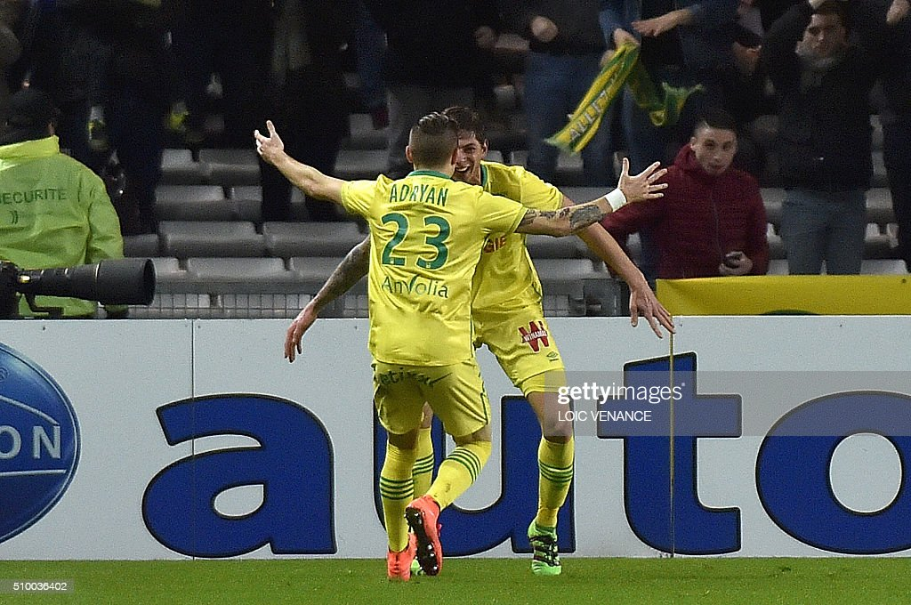 Nantes' Argentinian forward Emiliano Sala (R) celebrates with Nantes' Brazilian midfielder Adryan Oliveira Tavares after scoring a goal during the French L1 football match between Nantes (FCN) and Lorient (FCL) at La Beaujoire Stadium in Nantes, western France, on February 13, 2016. AFP PHOTO / LOIC VENANCE / AFP / LOIC VENANCE