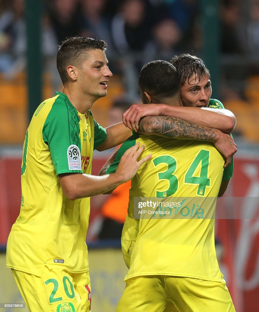 Nantes' Argentinian forward Emiliano Sala (R) celebrates with teammates after scoring a goal during the French L1 football match between Troyes (ESTAC) and Nantes (FCN) on August 19, 2017, at the Aube stadium in Troyes, eastern France. /
