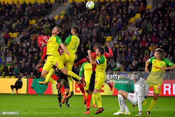 Nantes' Argentinian forward Emiliano Sala heads the ball during the French L1 football match Nantes vs Guingamps at the La Beaujoire stadium in...