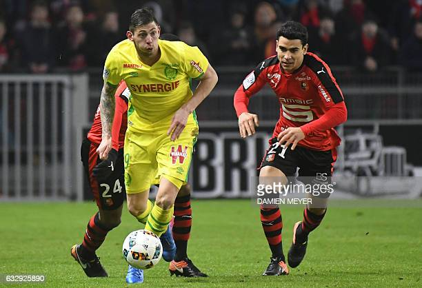 Nantes' Argentinian forward Emiliano Sala runs with the ball as Rennes' French midfielder Benjamin Andre attempts to block him during the French L1...