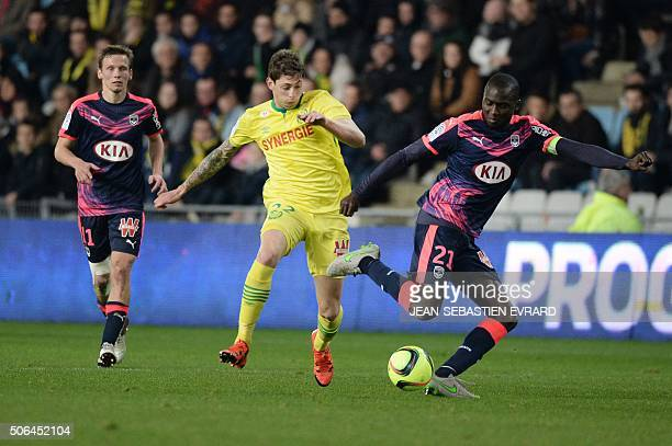 Nantes' Argentinian forward Emiliano Sala vies with Bordeaux's French defender Cedric Yambere during the French L1 football match between Nantes and...