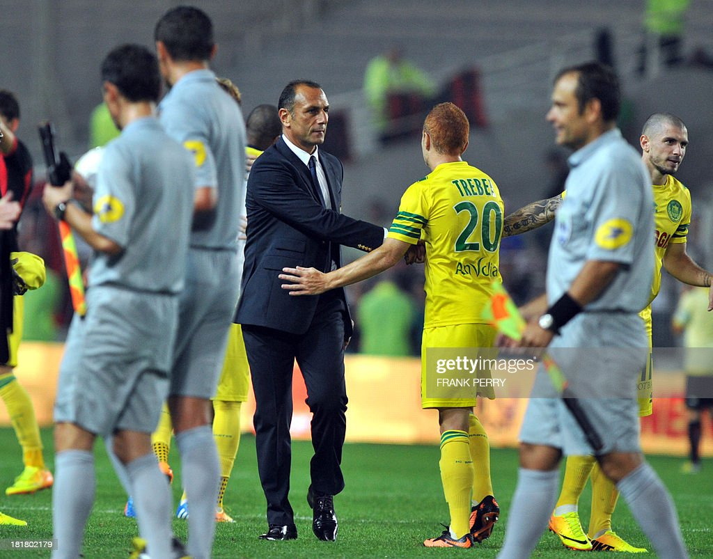 Nantes' Armenian-born French coach Michel Der Zakarian (C) congratulates his players after their victory at the end of a French L1 football match Nantes against Nice on September 25 , 2013 in La Beaujoire stadium in Nantes, western France. Nantes won 2-0.