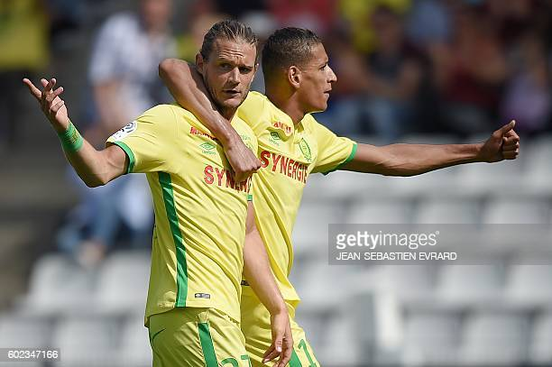 Nantes' Belgian midfielder Guillaume Gillet and Nantes' French forward Yacine Bammou react as a goal is refused by the referee during the French L1...