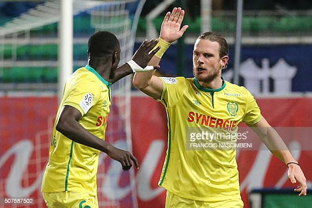 Nantes' Belgian midfielder Guillaume Gillet celebrates with a teammate after scoring a goal during the French L1 football match between Troyes and...