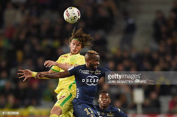 Nantes' Belgian midfielder Guillaume Gillet challenges Bastia's French midfielder Lenny Nangis during the French L1 football match between Nantes and...