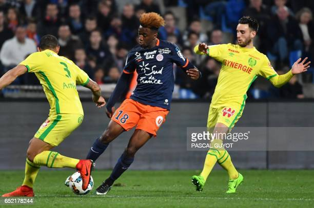 Nantes' Brazilian defender Diego Carlos and Nantes' French defender Leo Dubois vies with Montpellier's French forward Isaac Mbenza during the French...