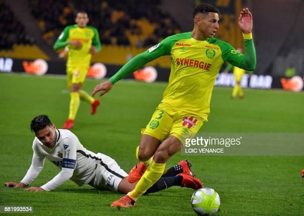 Nantes' Brazilian defender Diego Carlos vies with Monaco's Colombian forward Radamel Falcao during the French L1 football match Nantes vs Monaco at...