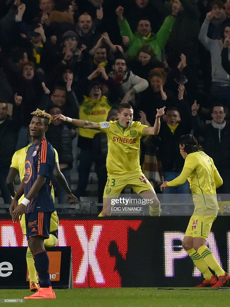 Nantes' Brazilian midfielder Adryan Oliveira Tavares (C) celebrates after scoring a goal during the French L1 football match Nantes vs Lorient, at the la Beaujoire stadium in Nantes, western France, on February 13, 2016. AFP PHOTO / LOIC VENANCE / AFP / LOIC VENANCE