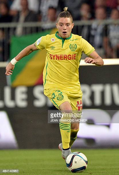 Nantes' Brazilian midfielder Adryan Oliveira Tavares runs with the ball during the French L1 football match between Angers and FC Nantes on August 15...