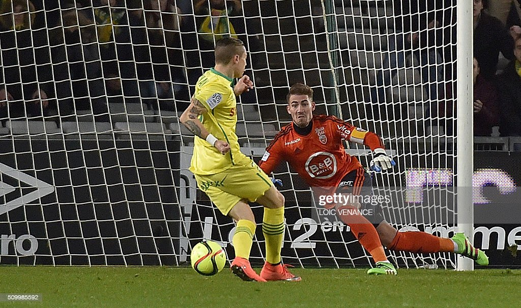 Nantes' Brazilian midfielder Adryan Oliveira Tavares scores during the French L1 football match Nantes vs Lorient, at the la Beaujoire stadium in Nantes, western France, on February 13, 2016. AFP PHOTO / LOIC VENANCE / AFP / LOIC VENANCE
