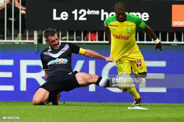 Nantes' Burkinabe forward Prejuce Nakoulma vies with Bordeaux's French midfielder Jeremy Toulalan during the French Ligue 1 football match between...