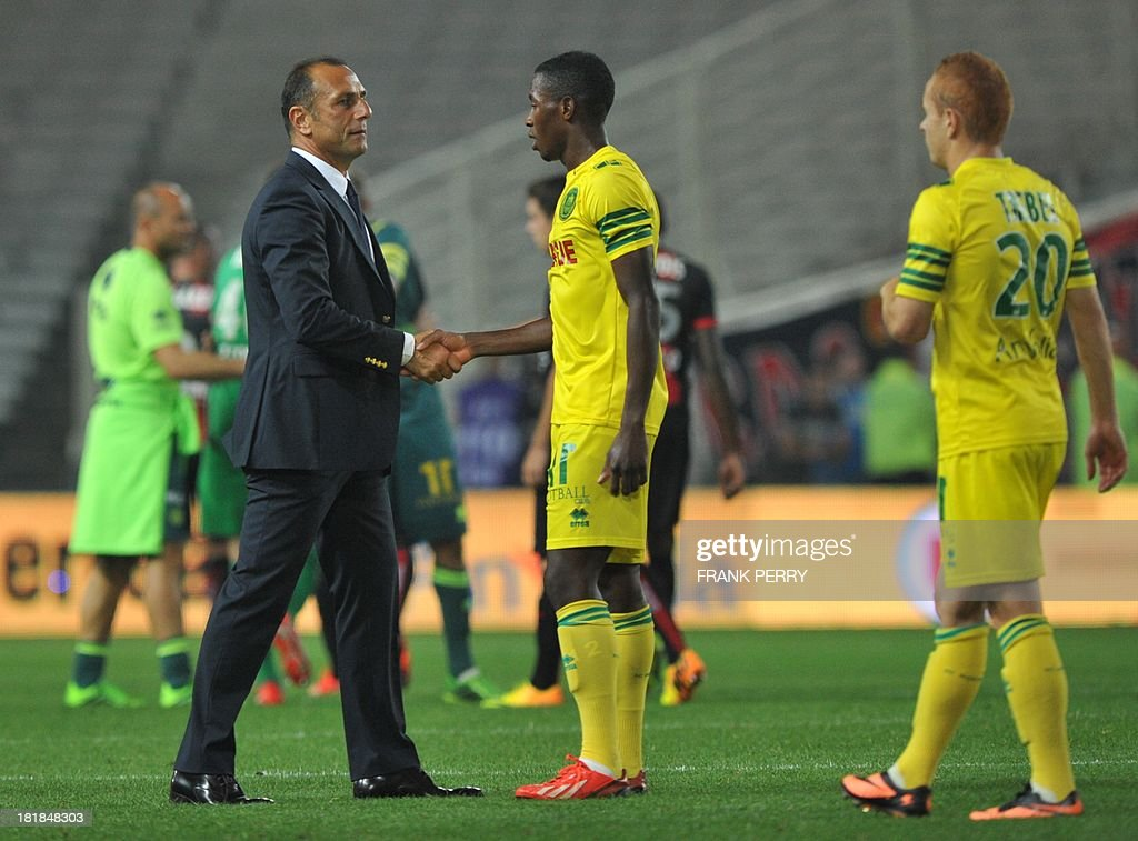 Nantes' coach Michel Der Zakarian (L) congratulates his players after the French L1 football match Nantes vs Nice on September 25, 2013 at La Beaujoire stadium in Nantes, western France.