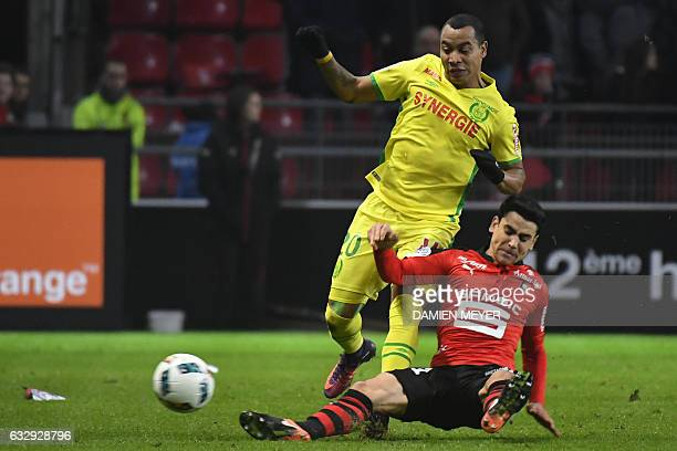 Nantes' Colombian midfielder Felipe Pardo tackles Rennes' French midfielder Benjamin Andre during the French L1 football match between Rennes and...