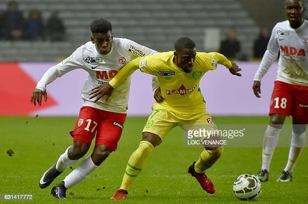 Nantes' Congolese midfielder Anthony Walongwa vies with Nancy's French defender Faitout Maouassa during the French League Cup quarterfinal match...