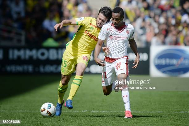 TOPSHOT Nantes' defender Leo Dubois vies with Bordeaux's Guinean forward Francois Kamano during the French L1 football match Nantes vs Bordeaux on...