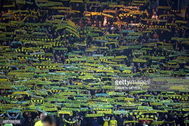 Nantes' fans cheer for their team before the French L1 football match Nantes vs Monaco on November 24 2013 at the Beaujoire stadium in Nantes western...