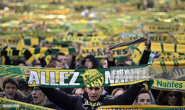Nantes' fans cheer on their team prior to the French L1 football match Nantes vs Guingamp on March 1 2015 at the Beaujoire stadium in Nantes...