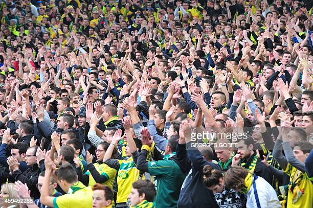 Nantes fans cheer prior to the French L1 football match Nantes vs SaintEtienne on November 23 2014 at the Stade de La Beaujoire in Nantes western...