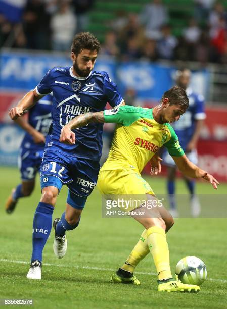 Nantes' forward Emiliano Sala vies with Troyes' defender Mathieu Deplagne during the French L1 football match between Troyes and Nantes on August 19...