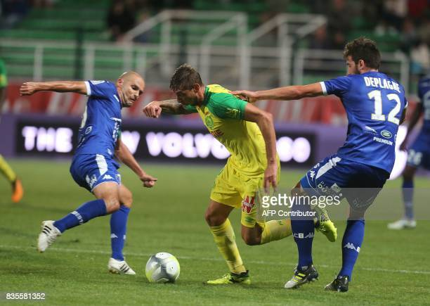 Nantes' forward Emiliano Sala vies with Troyes' French midfielder Benjamin Nivet and Troyes'midfielder Mathieu Deplagne during the French L1 football...