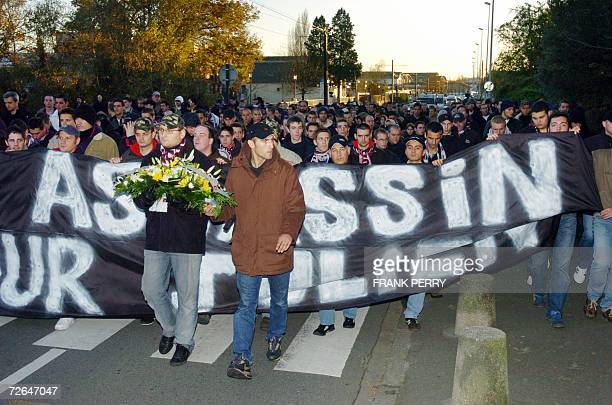 French Paris SaintGermain football team supporters from the Kop Boulogne Boys group march with Nantes team supporters 26 November 2006 in Nantes...