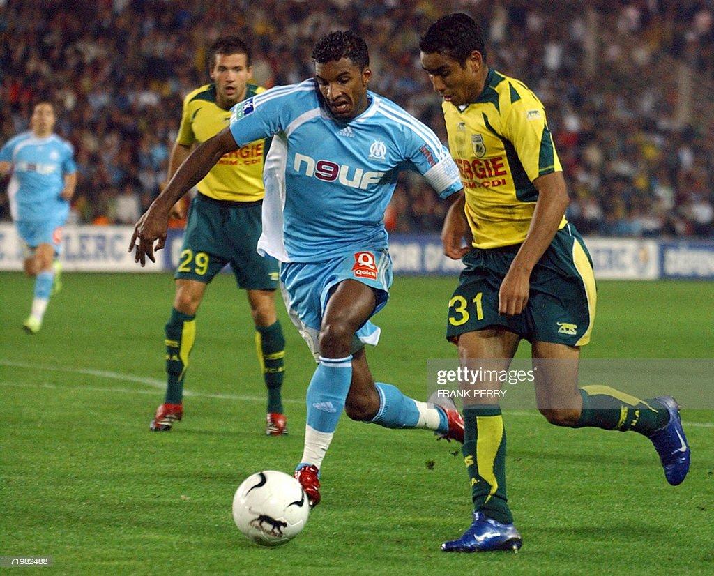 Nantes striker Dimitri Payet R vies w