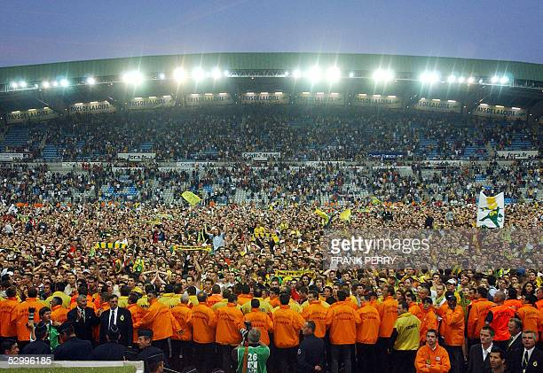 Nantes' supporters invade the field at the end of their L1 football match against Metz 28 May 2005 at the La Beaujoire stadium Nantes won 10 and keep...