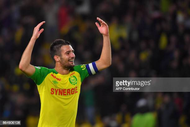 Nantes' French defender and captain Leo Dubois celebrates at the end of the French L1 football match Nantes vs Guingamps at the La Beaujoire stadium...