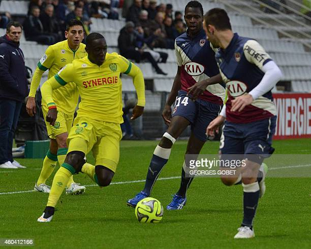 Nantes' French defender Issa Cissokho Bordeaux's Malian forward Cheick Diabate and Bordeaux's French midfielder Gregory Sertic vie for the ball...