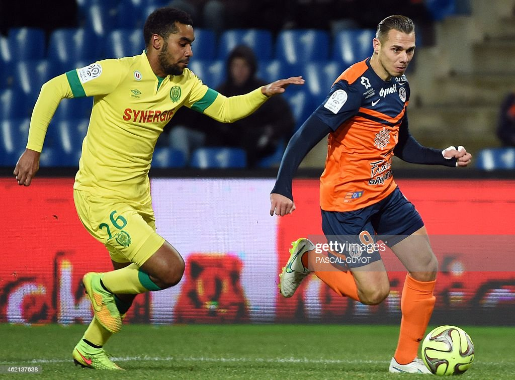 Nantes' French defender Koffi Djidji (L) vies for the ball with Montpellier's French forward Kevin Berigaud (R) during the French L1 football match between Montpellier (MHSC) and Nantes (FCN) on January 24, 2015 at the Mosson Stadium in Montpellier, southern France. AFP PHOTO / PASCAL GUYOT
