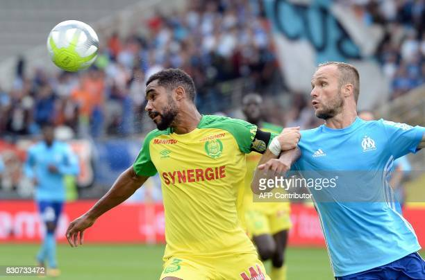 Nantes' French defender Koffi Djidji vies with Marseille's French forward Valere Germain during the French Ligue 1 football match between Nantes and...