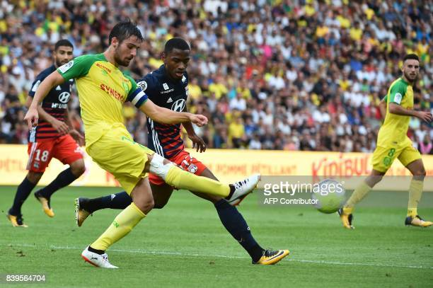 Nantes' French defender Leo Dubois vies for the ball with Lyon's French forward Myziane Maolida during the French L1 football match between Nantes...