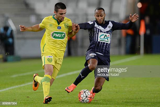 Nantes' French defender Leo Dubois vies with Bordeaux' French forward Thomas Toure during the French Cup round of 16 match between Bordeaux and...