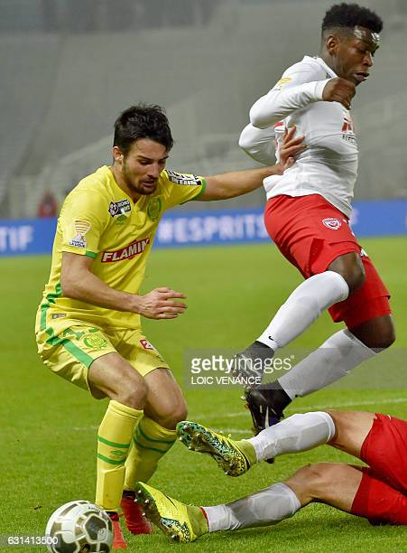 Nantes' French defender Leo Dubois vies with Nancy's French defender Faitout Maouassa during the French league cup quarter final match Nantes vs...