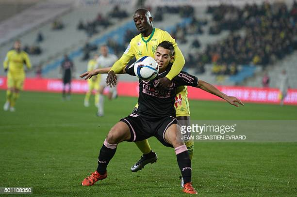 Nantes' French defender Youssouf Sabaly vies with Toulouse's French forward Wissam Ben Yedder during the French Ligue 1 football match between FC...