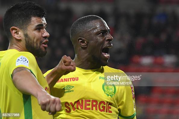 Nantes' French forward Jules Iloki reacts as he celebrates after scoring a goal during the French L1 football match between Rennes and Nantes on...