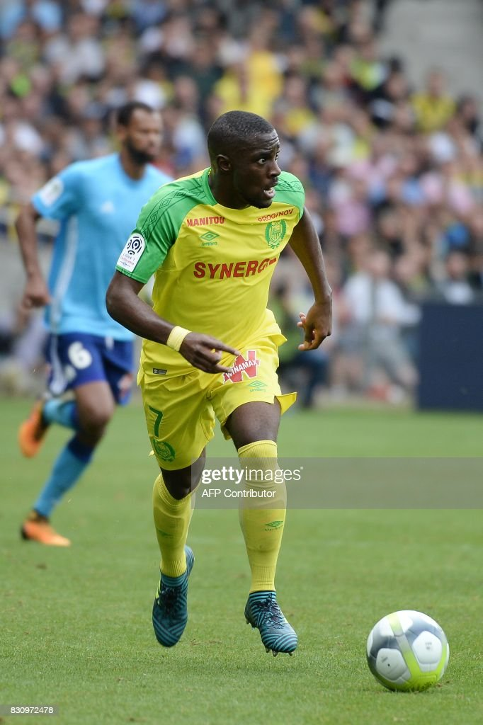Nantes' French forward Jules Iloki runs with the ball during the French Ligue 1 football match between Nantes (FCN) and Olympique de Marseille (OM) on August 12, 2017 at Beaujoire stadium, in Nantes, western France. /