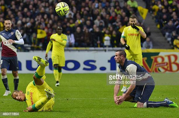 Nantes' French forward Yacine Bammou and Bordeaux's French defender Nicolas Pallois play the ball during the French L1 football match FC Nantes vs...