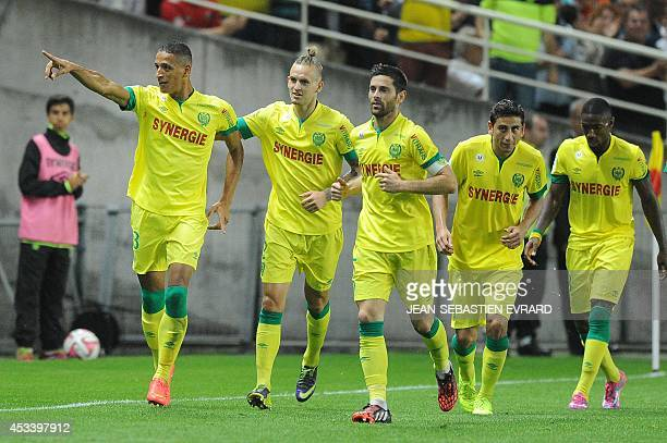 Nantes' French forward Yacine Bammou celebrates with his teammates after scoring during the French L1 football match Nantes vs Lens at the Beaujoire...