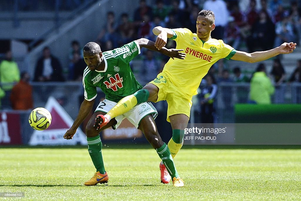 Nantes' French forward Yacine Bammou (R) vies with Saint-Etienne's French defender Kevin Theophile-Catherine (L) during the French L1 football match Saint-Etienne (ASSE) vs Nantes (FCN) on April 12, 2015, at the Geoffroy Guichard Stadium in Saint-Etienne, central France.
